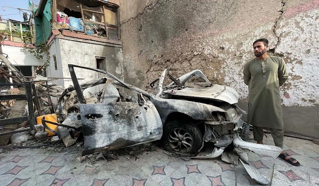 Damaged house and car after a US drone strike that killed nine members of a family in Kabul, August 2021. Photo: AFP