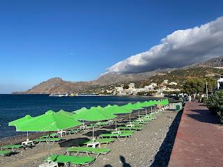 Plakias beach and green umbrellas.