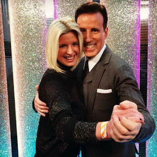 Sarah Stirk posing for picture of with her co-host