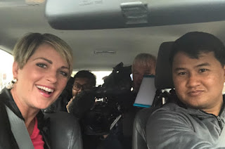 Jamie Yuccas clicking selfie with her crew while sitting inside the car