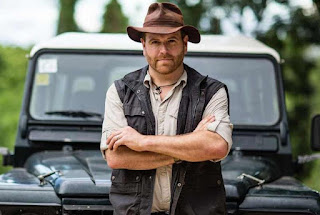 Josh Gates posing for a picture with Jeep in the background