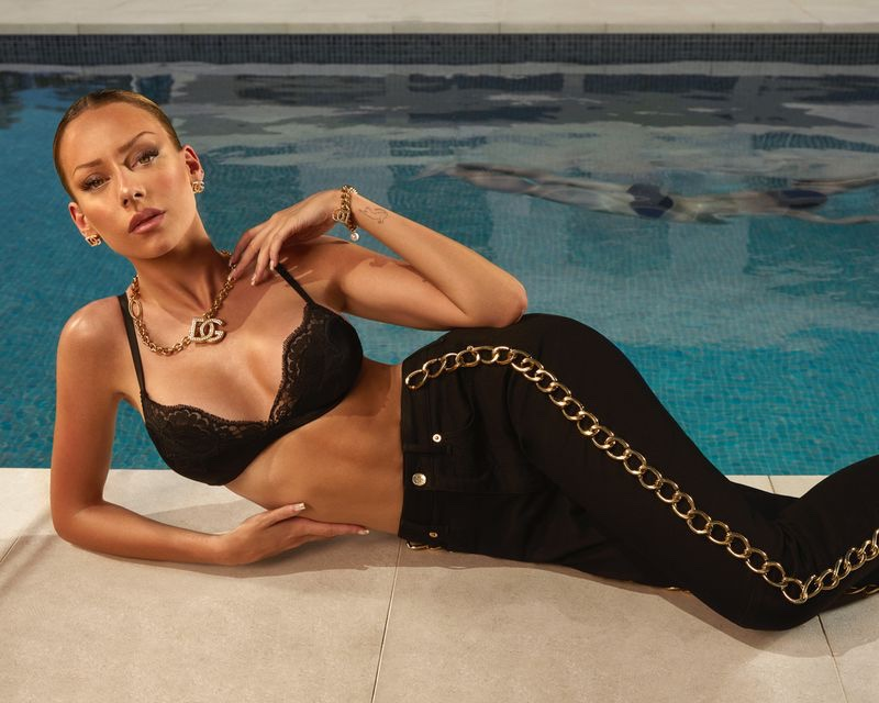 Wearing lingerie, Ester Exposito poses in Dolce & Gabbana's 90s collection.