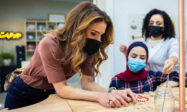 Queen Rania wore a braided high rise flared leg jeans by Chloe. Hirotaka toggle pearl chain earrings