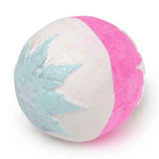 A pink and silver spherical bath bomb with a silver snowflake engraved into it on a bright background