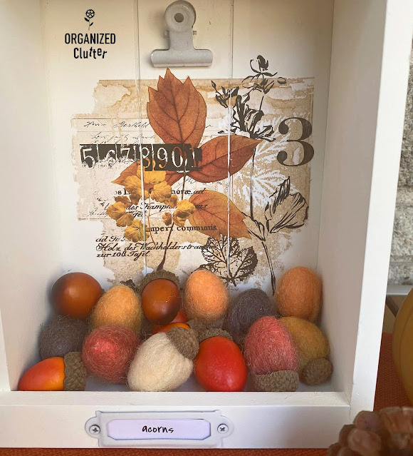 Photo of fall small decor decorating a shadowbox.