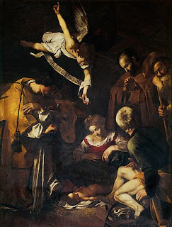 Caravaggio's painting Nativity with St Lawrence and St Francis