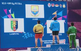 m rifqi ramadhan lifter jambi meraih emas pon xx papua
