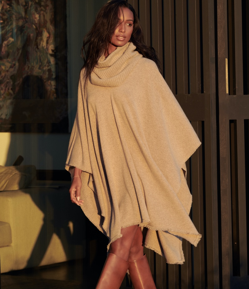 Wearing a poncho, Jasmine Tookes fronts NAKEDCASHMERE NAKED in October 2021 campaign