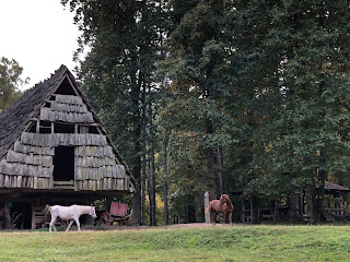 horses in front of old barn