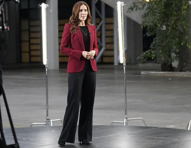 Crown Princess Mary wore a wine red crepe blazer by Alexander McQueen, and black wide leg trousers