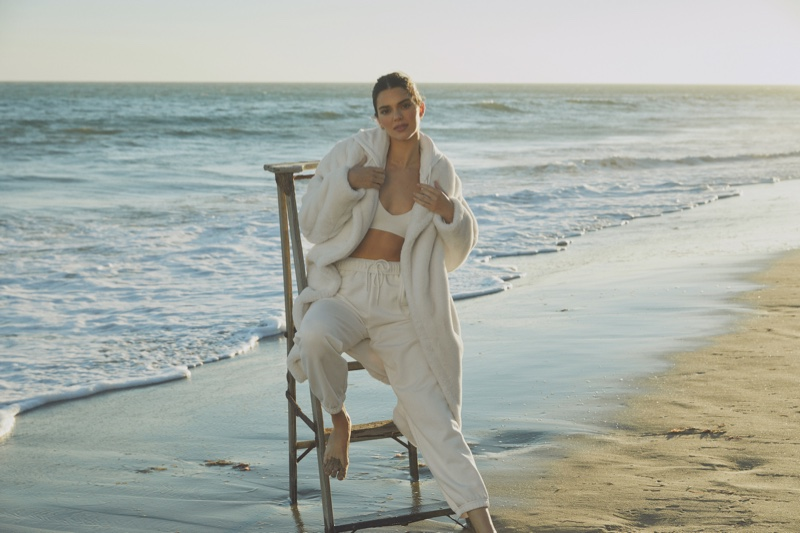 Dressed in white, Kendall Jenner layers up in Alo jackets & coats campaign.