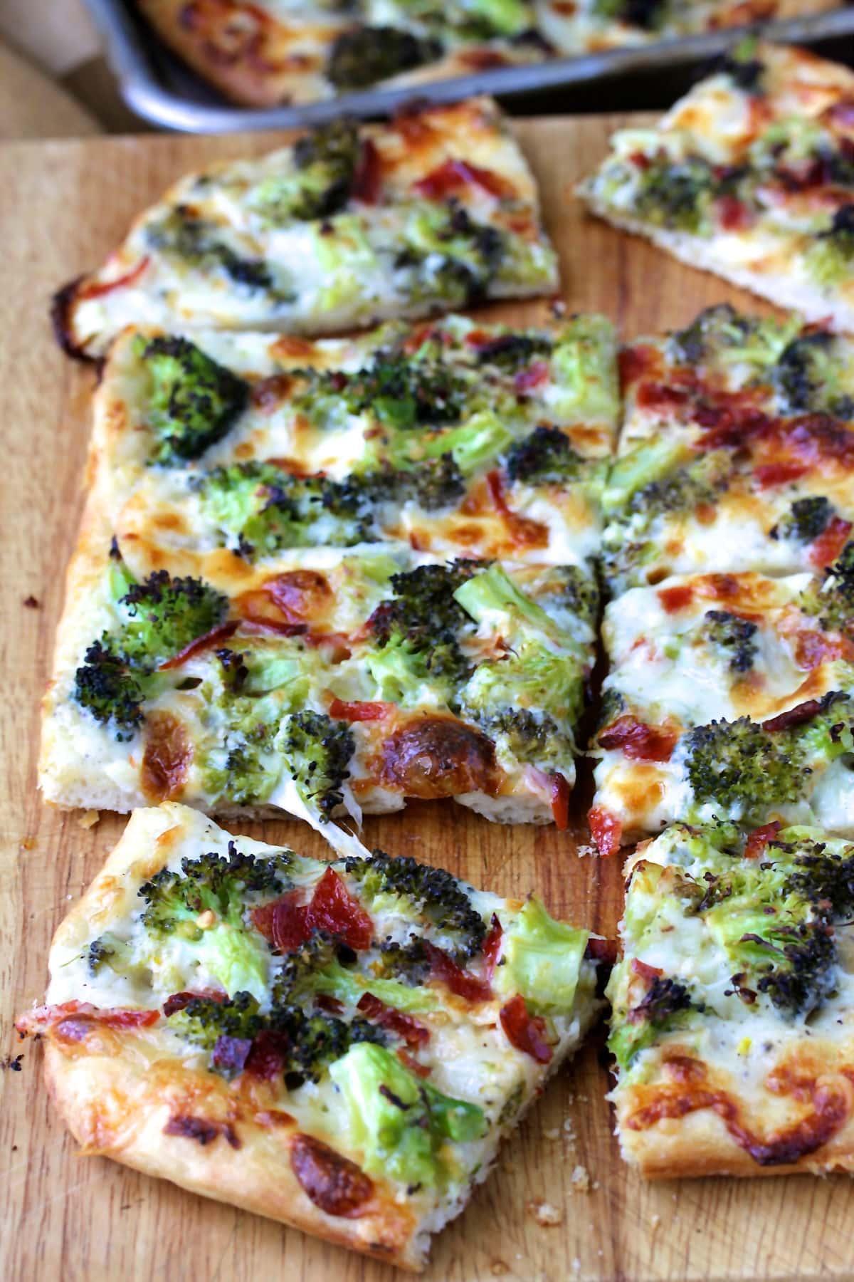 Broccoli Pizza with Provolone, Mozzarella, and Pecorino Romano sliced.