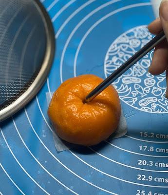 Bánh bao được nấu chín sẽ giống hệt quả cam