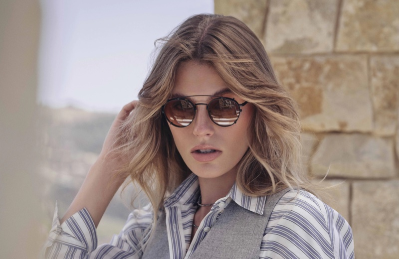 Madison Headrick poses for Brunello Cucinelli x Oliver Peoples eyewear campaign.