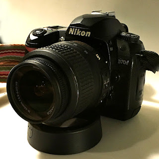Nikon D70s camera with VR 18-55 lens attached