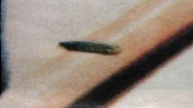 Photographed by Voyager is a huge and i mean UFO parked up in Saturn's rings.