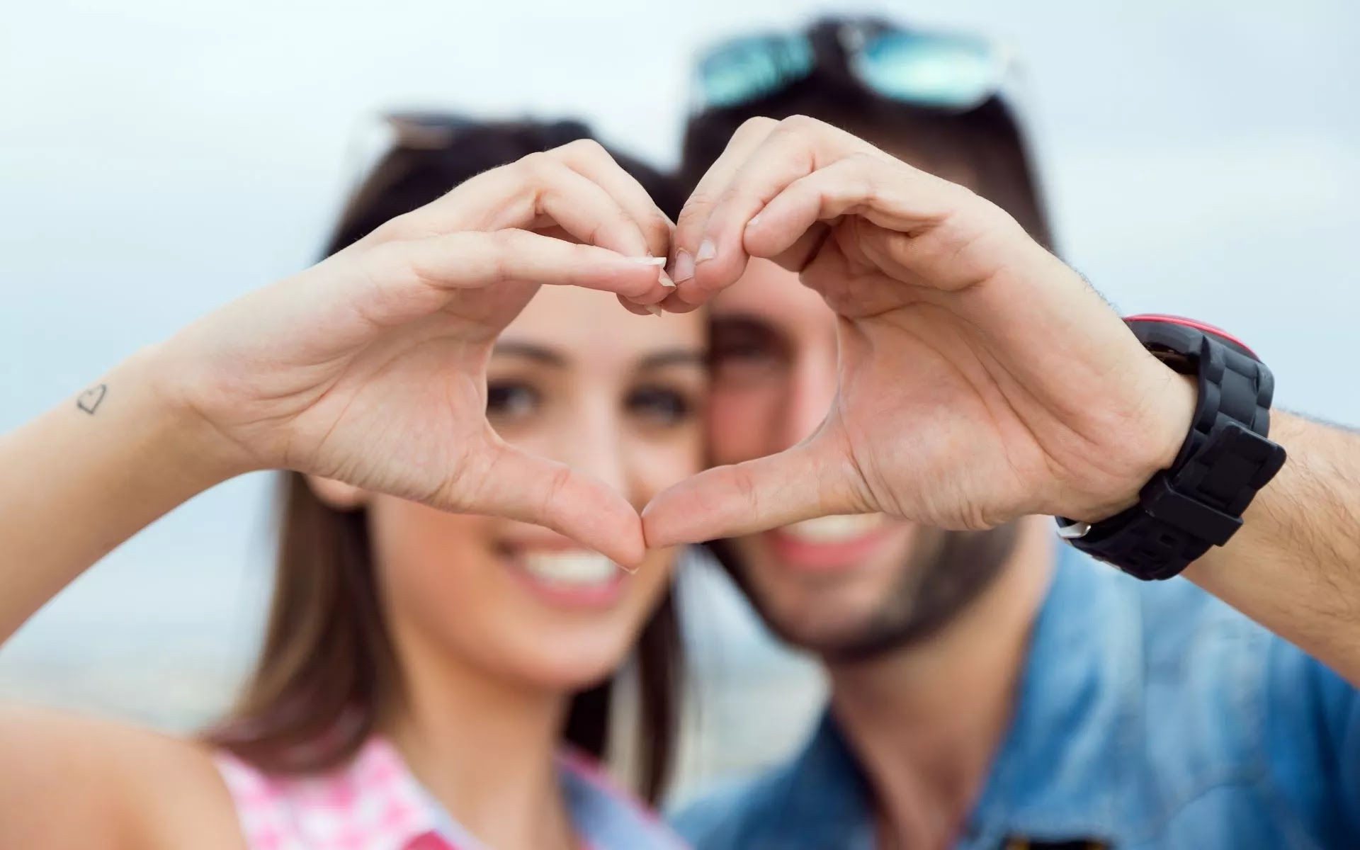 heart sign from hand love couple pic