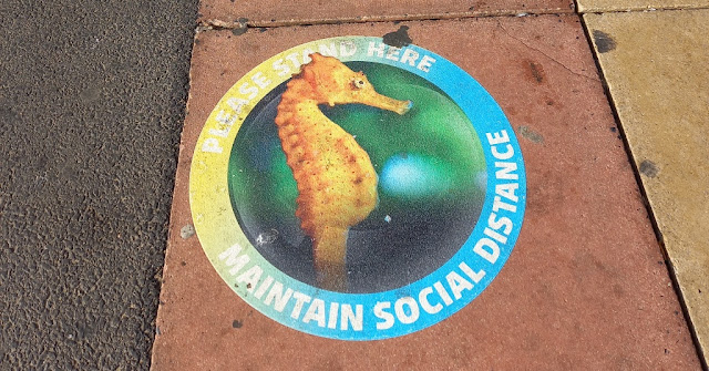 Social distancing sign at the SEA LIFE centre in Blackpool