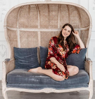 Rachel Drance posing for photo while sitting in a sofa