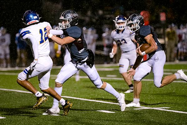 Tyler Hensch provides a lead block