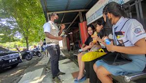 Warga Dan Pelajar Apresiasi Kolaborasi BPBD Bersama Wartawan Biro Bitung Bagikan Masker
