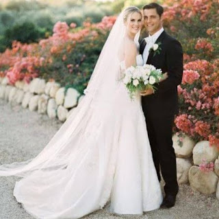 Cassidy Boesch with her Husband Sam page in their wedding dress