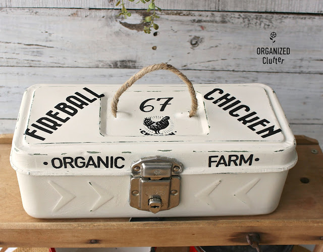 Photo of a farmhouse style toolbox makeover with rub on transfers.