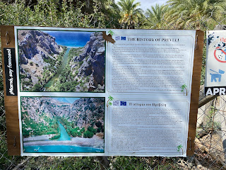 Informational sign at Preveli Palm Forest explaining history.