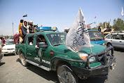 Pengikut QAnon Berpikir Runtuhnya Afghanistan ke Taliban Adalah 'Bendera Palsu'