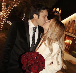 Picture of Michel Saenz Castro kissing his mysterious wife