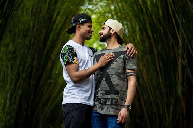 two men hugging in bamboo forest - bamboo as eco-clothing