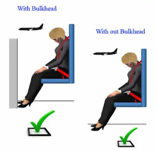 Brace position in forward-facing cabin crew seats, without and with a bulkhead