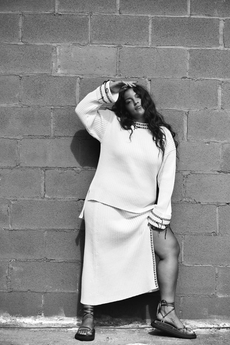 Paloma Elsesser poses in Zara Whip Stich Knit Sweater & Ribbed Knit Skirt.