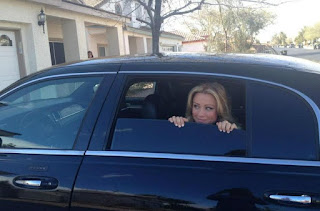 Casey Noble sitting inside the car