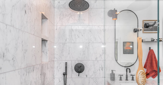 Spa shower wet room in a white and gray bathroom.