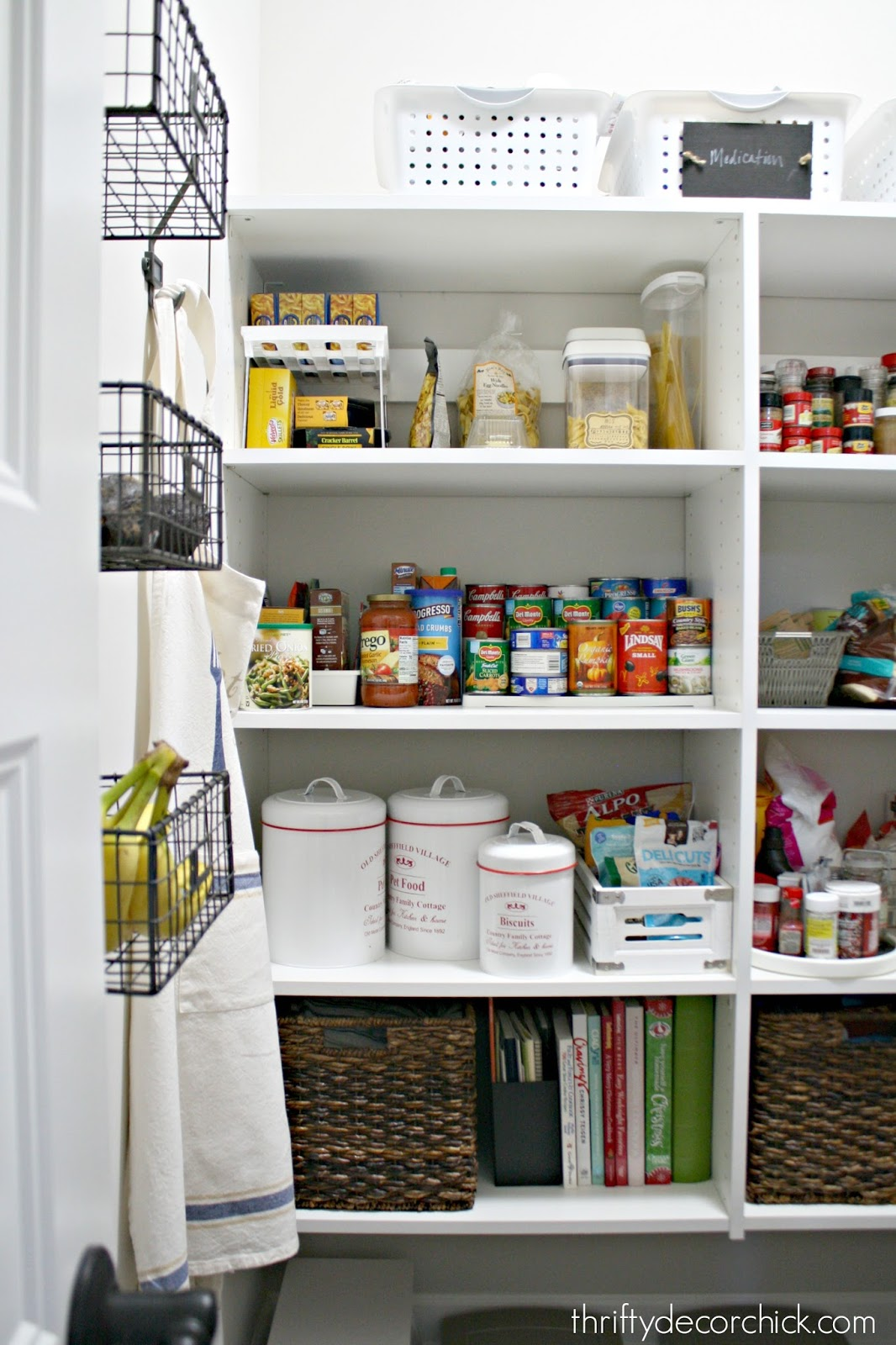 pantry with white shelving