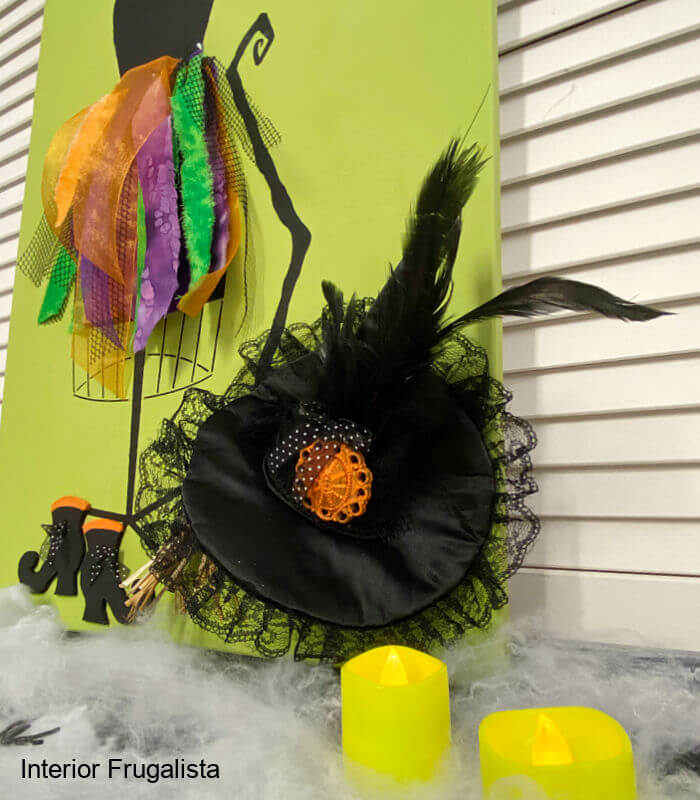 A unique hocus pocus bohemian witch scrap wood 3D halloween porch sign with a colorful rag skirt witch costume on a stenciled mannequin dress form.