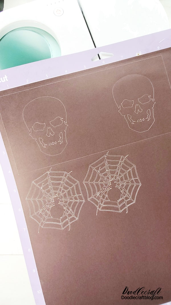 Step 1: Cut Infusible Ink Begin by selecting a design from Cricut Design Space. I picked a skull and a spider in a web. I love that the skull released the shape that I could use on a second mug.  Design the canvas by selecting the square shape, place one on the canvas, then unclick the lock icon so you can change the measurements separate of each other. Make the width 8.75 inches and the height 4 inches.   Then add the skull image on both sides of the rectangle, slice the images together and boom, ready to cut!   Mirror the image. Place the infusible ink on the strong grip mat and use the brayer to roll it in place. touch it as little as possible.  Then select the material and cut it out.