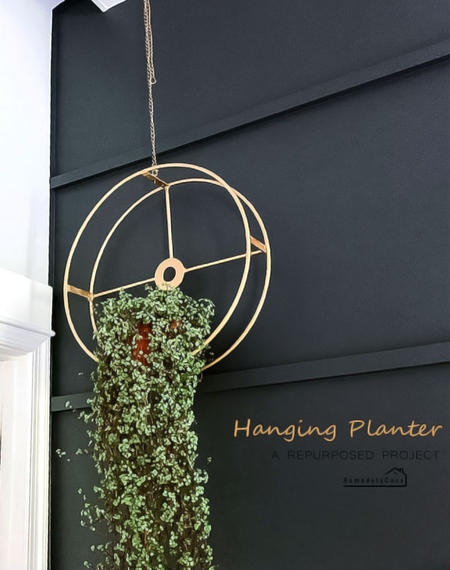 a hanging planter made of recycled materials