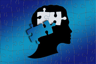 Image of a person's head as a jigsaw puzzle with two pieces displaced