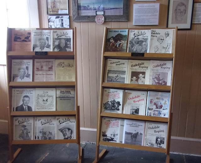 Booklets depicting lives of those who have lived in Oakdale, California, are displayed for sale on a rack