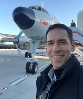 Picture of Morgan's husband Stefan clicking selfie with airplane