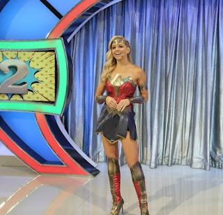 Tiffany Coyne hosting the show wearing wonder woman dress
