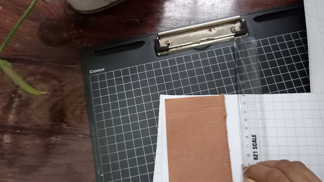 Take a thick piece of cardboard for the base