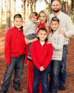 Christine Bui Allegra with her spouse Karl Anderson with their kids