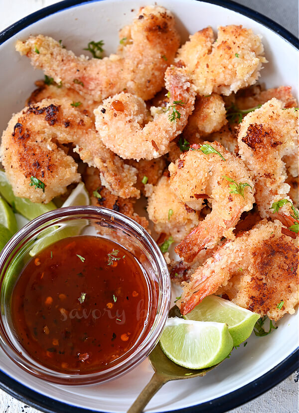 a closer look at white plate with crispy coconut shrimp