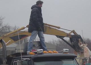 Andrea Bock's partner Ty Pennington standing in a car