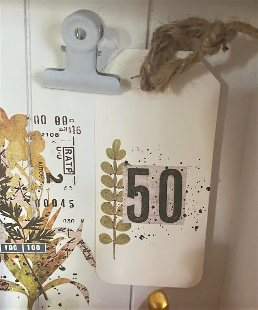 Photo of a paper tag with a fall decor transfer.
