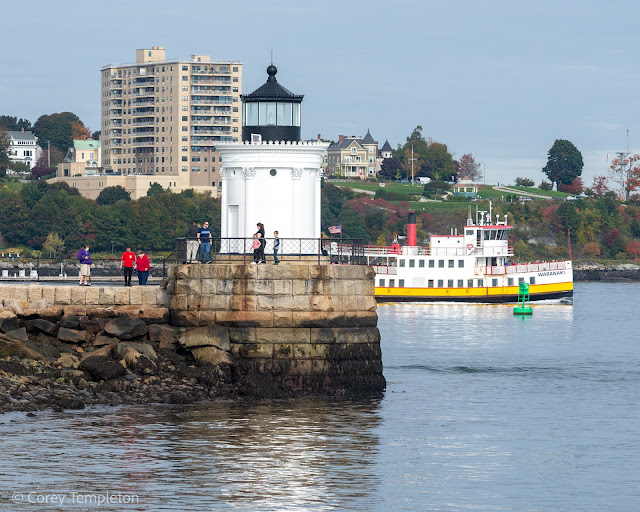 Portland, Maine Photo by Corey Templeton October 2021. The Wabanaki ferry passing behind Bug Light on a crisp fall day.