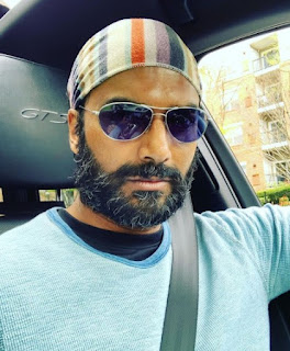 Halina Ramamurthy's father Sendhil clicking selfie while sitting in a car